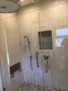 Porcelain walls and pebbles shower floor and accent
