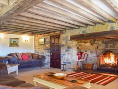 This truly magnificent farmhouse boasts a roaring open fire for those cosy nights in. Living Room On A Budget, Living Rooms, Cosy Lounge, Cosy Night In, Open Fires, Farmhouse, Bed, Cottages, Places