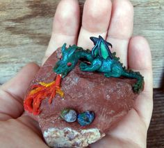 Decorative Fire-breathing mother dragon and her eggs on a stone. An unusuall home decor by MadDollStudio Polymer Clay Creations, Dragon, Eggs, Fire, Ornaments, Stone, Trending Outfits, Unique Jewelry, Handmade Gifts