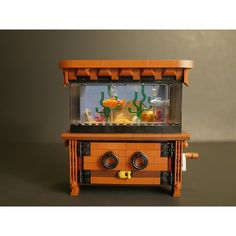 """""""A little aquarium comes to life as these LEGO fish really move [Video]""""   Have you ever wanted a low-maintanence aquarium that you could take with you? Look no further! Mark Smiley has the aquarium just for you! Click to see how it works! #LEGO #Models #Aquarium #Fish #Ideas #KineticArt #brothersbrick #MOC #AFOL #legos #legostagram #legophotography #legogram #legomoc #legodesign #legoart #legocreation #toys #toyphotography #legophotography #brickstagram #productphotography #build #buildlego…"""