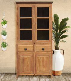 From our recycled teak collection comes this beautiful small cupboard with glass doors, 2 drawers and lower cabinets revealing plenty of spacious storage. #teak #teakfurniture #woodfurniture #cupboard #chinacabinet #homedecor #curiocabinet