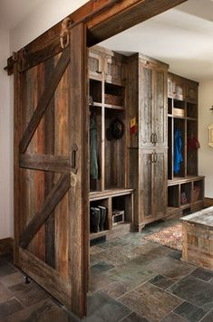 Barnwood mudroom....perfect! Great sliding barn door too. I would want the wood to be a little softer - and maybe stained or painted so it doesn't look so overly rustic, though.