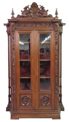 Italian carved oak china cabinet.