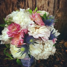 Denise's bouquet // Dahlias. Roses, Thistle and Spray Roses. This bride was to marry her groom at Sevens at the base of Peak 7 at the Breckenridge Ski Resort.