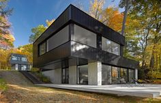 lake house, Black House Paint Exterior Design With Wooden And Concrete Material: Cool and small minimalist modern cube house design in the l. House Siding, House Paint Exterior, Exterior Design, Exterior Siding, Exterior Stairs, Black Exterior, Modern Exterior, Residential Architecture, Architecture Design