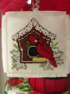 Counted cross stitch cardinal and birdhouse ornament. $10.00, via Etsy.