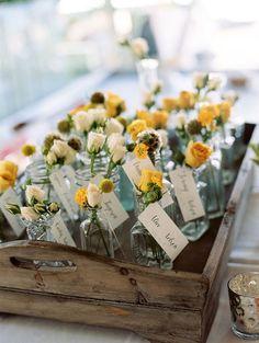 flowers in bottles as escort cards http://weddingwonderland.it/2015/07/matrimonio-botanico.html