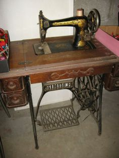 Found on EstateSales.NET: Treadle Singer sewing machine - familiar as a child with every inch of this machine