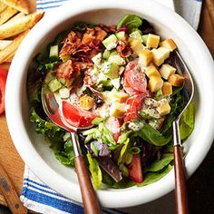 Turn a classic BLT into a main dish salad. The favorite combination of bacon, lettuce, and tomato are added to a mix of vegetables and toasted bread to make a delightful meal. Creamy mustard dressing makes the perfect topping.