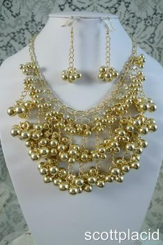 """CHUNKY GOLD TONE FAUX PEARL GOLD TONE METAL BIB NECKLACE SET WITH CRYSTAL ACCENTS    * If you need a necklace extender I have them for sale in my store.*      NECKLACE: 21"""" LONG + 3"""" EXT                 HOOK EARRINGS                    COLOR: GOLD TONE  $24.99"""