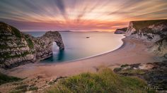 "Durdle Door Sunset - Check my <a href=""http://xaviermartyn.wixsite.com/martynphotography"">Website</a> and my <a href=""https://www.facebook.com/xaviermartynphotography/""> Facebook Page </a>if you like my work!!!  Durdle door with one very long exposure."