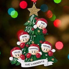 Family Around Christmas Tree Ornament - Gather everyone around the Christmas tree—literally! There's room for the entire family on this adorable ornament.