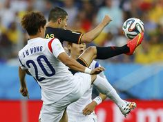 South Korea's Hong Jeong-ho fights for the ball with Belgium's Kevin Mirallas during their 2014 World Cup Group H soccer match at the Corint...