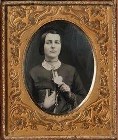 ca. 1850, [daguerreotype portrait of a woman with love token and daguerreotype