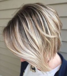 short haircut with long front layers. Blond highlights with darker roots and under layer