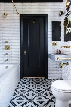 Geometric tiles are a great alternative to the Moroccan or Mediterranean vibe of many cement tiles. A cool pattern like this one can really add some personality to a small bathroom, especially if you paint the door to match the darker color, to carry the eye back up. (via Domino)