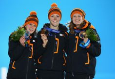 DAY 10:  (L-R) Silver medalist Ireen Wust of the Netherlands, gold medalist Jorien ter Mors of the Netherlands and bronze medalist Lotte van Beek of the Netherlands  during the medal ceremony for Speed Skating Women's 1500m