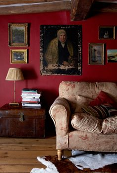 I loooooove this! Makes me contemplate dark red walls in living room. Beamed ceiling and dark red walls above sofa in Century Oxfordshire living room.