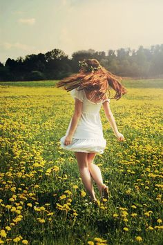 Girl in a white dress running in a field of flowers Via pastriesandpartydresses.tumblr