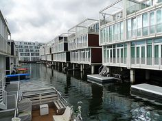 IJburg, Amsterdam.  Built on artificial islands in IJ Lake, IJburg has residences, offices, shops & 45,000 people will live and work there when it's completed. London to build a floating village on the Thames The historic Royal Docks, on the banks of the Thames, will soon be home to Europe's largest floating village.