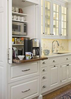 Hakansson: Creative Kitchen Storage Solutions a coffee center located on a counter-height pullout shelf and a microwave on a shelf above.a coffee center located on a counter-height pullout shelf and a microwave on a shelf above. Kitchen Storage Solutions, Diy Kitchen Storage, Kitchen Redo, Kitchen Pantry, New Kitchen, Kitchen Ideas, Kitchen Counters, Pantry Ideas, Kitchen Cupboards