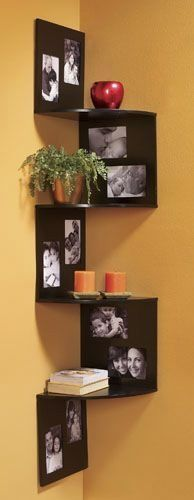 corner shelves with matching picture frames on either side (above-left, then underneath-right) the whole length of the shelf space