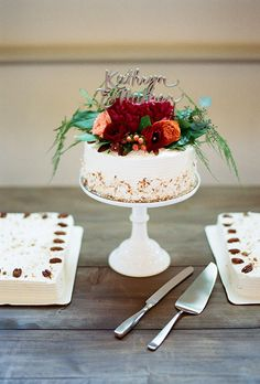 Brides.com: . A one-tier white wedding cake topped with lush fresh flowers and greenery and a metallic topper, created by WPA Bakery.