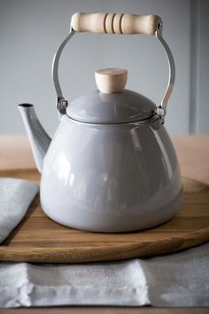 A simple gray stove kettle for brewing tea with style.
