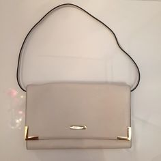 """Michael Kors Beverly Oversized Clutch Shoulder Bag Authentic. Beautiful vanilla leather (like an off white/pale nude color). Gold hardware. Magnetic snap closure. Detachable shoulder strap (11.5"""" strap drop). Snap slip pocket in back. Inside: slip pocket (1), zip pocket (1), credit card slots (6).  Very classy looking. Used once for a wedding. Few minor discolorations that aren't very noticeable (one near front bottom, one on back- see pics)   Vanilla/Gold  11.25""""L x 7""""H x 2""""D  ❗️ No trades…"""