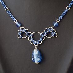 chainmaille blue necklace - pinning cause I think it might be neat to make a longer (full necklace) undulating circles like at the bottom there