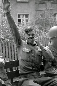 A U.S. soldier mocks Hitler for the camera in World War II.