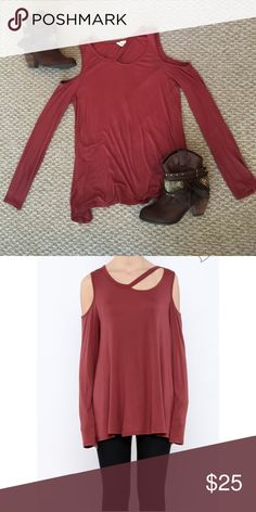 Cold Shoulder cut-out neckline Burnt red cold shoulder top, cut-out neckline, flowy silhouette, runs large. Wore once for a concert, bought from a local boutique. 1.4.3. Story by Lineup Tops