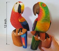 The Couple - Set of 2 Jungle Parrots - Hand Carved Balsa Wood Fine Artisanry - Handmade Carving - Decoration Birds by JungleBirds. $38.99. The Couple is a set conformed by 2 handmade pieces which are 12 inches tall each.. These balsa wood carvings are made by hand with exotic colors and designs inspired in the flora and fauna of the Amazon rainforest.. This unique set was carved just for you in resemblance of the Scarlet Macaw and the Red-lored Amazon species.. The Couple i...