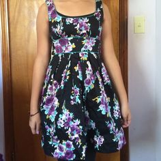 SALECute Floral Mini/Midi Dress Teeze Me dress thats lands about 2 inches above the knee with 1 1/2 inch straps. Its black with purple and blue flower clusters on it. Juniors size 3 that ties in the back and has a zipper. Adorable dress on anyone and has only been worn once! Make me an offer(: Teeze Me Dresses Mini