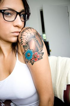 Considering something like this. Book with shading, colored flowers around bottom. Or some other colored design to accent.