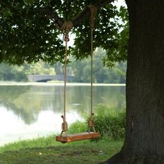 Ultimate Swing, Made from Reclaimed Wood - Gardenista Swing with fisherman's knot instructions. I like the way the rope holes are hollowed out!Swing with fisherman's knot instructions. I like the way the rope holes are hollowed out! Backyard Hammock, Hammock Swing, Porch Swing, Wood Swing, Outdoor Fun, Outdoor Decor, Outdoor Seating, Outdoor Tables, Outdoor Spaces