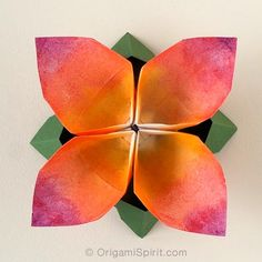 Origami flower -Four- petal. An updated and improved video tutorial. Flor en origami. #origamiflower #origami