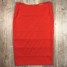 Orange midi pencil skirt Orange midi pencil skirt. Gold zipper in back. 22 inches long. Rayon polyester 5% spandex. Tag reads small. Alythea Skirts Midi