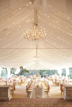 Beautiful Wedding Tent Ideas: Draped Fabric and Chandelier