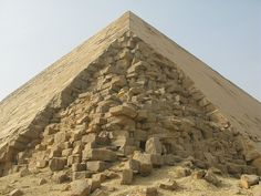 """Dashur (Egypt) The Bent Pyramid, of Old Kingdom Pharaoh Sneferu, is a unique example of early pyramid development in Egypt, about 2600 BC. This was the second pyramid built by Sneferu. The lower part of the pyramid rises from the desert at a 55-degree inclination, but the top section is built at the shallower angle of 43 degrees, lending the pyramid its very obvious """"bent"""" appearance."""