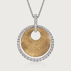 Simon G .44 Carat Total Weight Diamond and 18-Karat Two-Tone Gold Disc Necklace. A beautiful exploration of contrast, this Simon G. necklace juxtaposes tones and textures to create high-impact style. The centerpiece of the two-tone design is a textured 18-karat yellow gold disc, which has the gorgeous unrefined appeal of a bygone era.