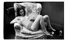 Stanley Kubrick for Look Magazine, Show Girl [Rosemary Williams laying in a chair.], 1949.