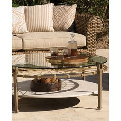 Hemingway Outdoor Round Glass Coffee Table ($1,750) ❤ liked on Polyvore featuring home, outdoors, patio furniture, outdoor tables, natural, round outdoor patio table, glass shelves, outdoor shelves, round outdoor coffee table and round patio table
