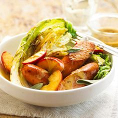 Fresh apples lend a touch of fall flavor to napa cabbage and smoked bratwurst. Sour cream, sage, and Dijon-style mustard dressing adds zest.