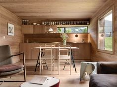 Occupying a small hilltop in the Swiss Alps, Sarreyer Cabin is a modern mountain chalet hidden inside a rustic shell. Rough-cut logs and a rusty. Swiss Chalet, Swiss Alps, Bunk Bed Ladder, Timber Panelling, Oak Panels, Interior Minimalista, Tiny Cabins, Wooden Stairs, Small Windows