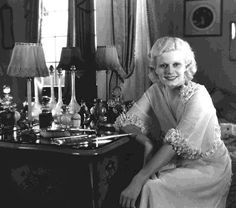 Jean Harlow 1911 – 1937  vintage Hollywood stars and burlesque performers at their dressing tables. I love the way that each woman's femininity is enhanced by being pictured next to, or using their dressing tables. These photos are a real celebration of star power, glamour and female allure...