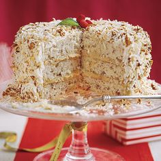 Cake Recipes: Great Christmas Cake! Caramel Cream Cake - Enjoy tender coconut-pecan cake layers filled with pecan pie filling. The top and sides of the cake are spread with cream cheese frosting and sprinkled with toasted coconut and pecans for an impressive (but super-easy) finish.