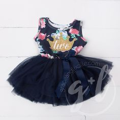 """A royally fitting dress for your little princess' first birthday! Super sparkly gold crown and number """"two"""" centered on front. Premium cotton/spandex sleeveless top with attached extra-full navy tulle"""