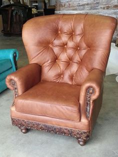 The Cohiba tufted wing chair.