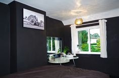 Our Sexy New Black Bedroom-  Walls in Crown Rebel. White Curtain Pole, black wood flooring. Photo by Hearty Rose Campbell